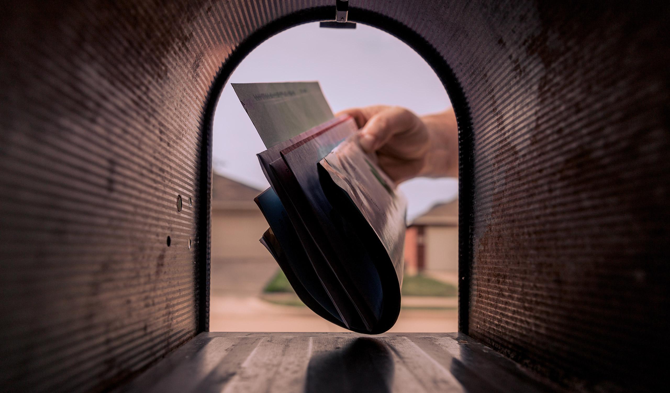 Mailman Delivering Mail