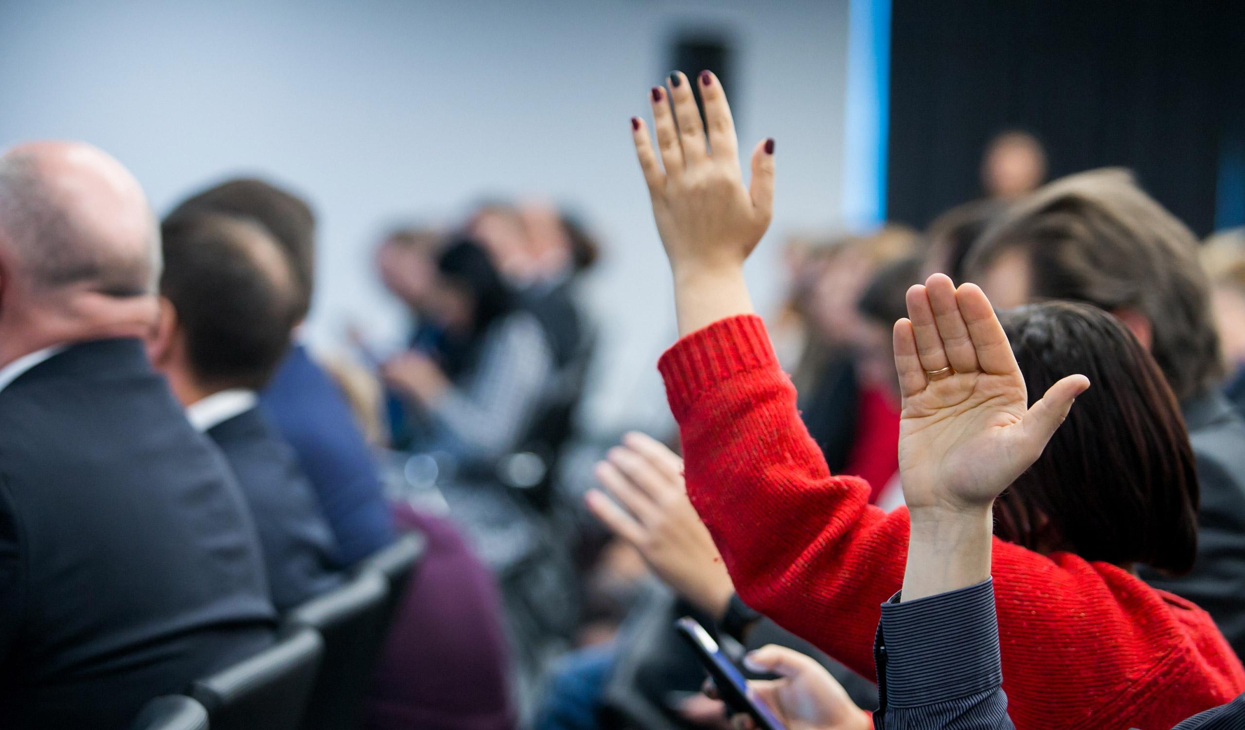 raising hand during seminar