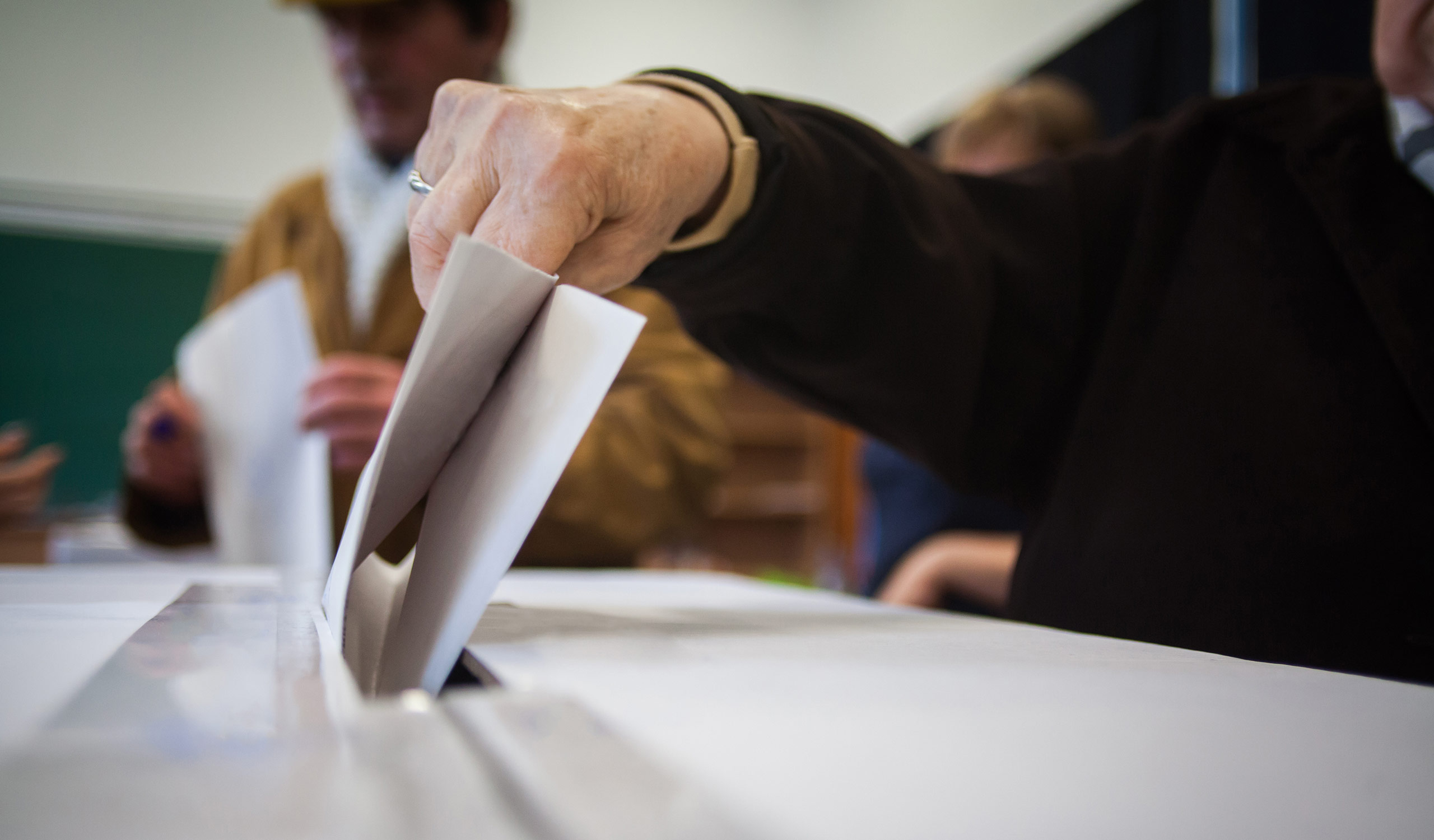 Man submitting his vote